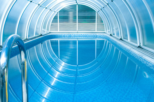 Covered summer pool with a blue tile.