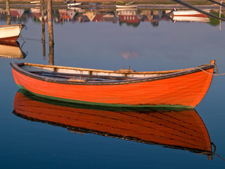 Reflection of a small dinghy dory boat