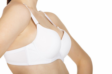 Woman breast in uplift on a white background