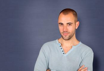 Handsome man standing on blue background