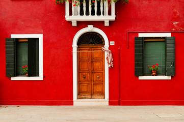 Old red wooden door and windows