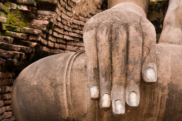 Hand of Buddha statue on right