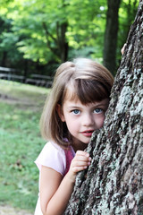 Child Leaning Against an Oak Tree