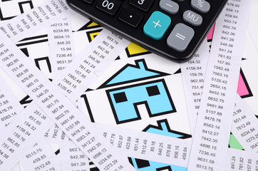 Receipts,calculator and house