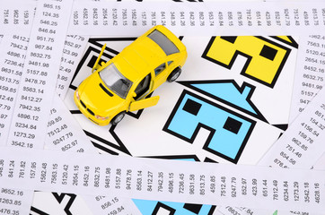 Receipts and house with toy car