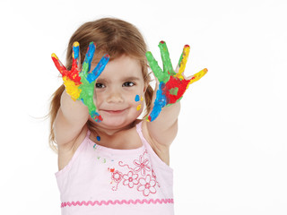 Little adorable girl playing with her color painted hands
