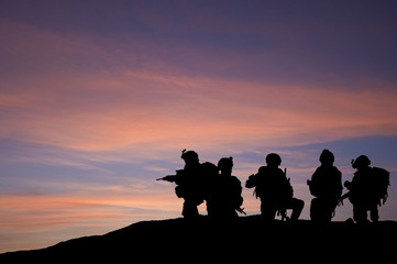 Silhouette of modern troops in Middle East silhouette