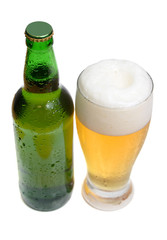 beer is in a bottle and glass