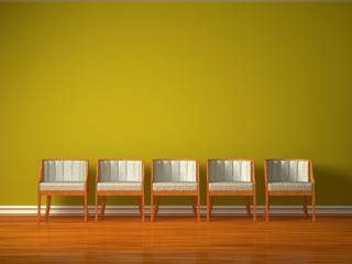 Row of five chairs in green interior