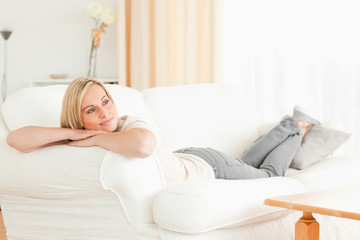 Calm woman lying on her sofa