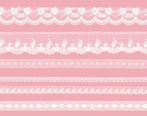 dentelle blanche sur fond rose