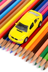 Toy car and color pencils