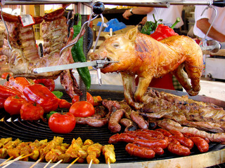 pig, meat and vegetables in course of barbecue preparation at sp