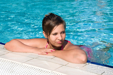 beautiful girl in the swimming pool