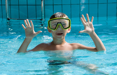 cute boy wearing in yellow goggles