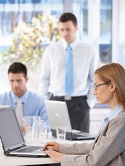 Young businesswoman and team working in office