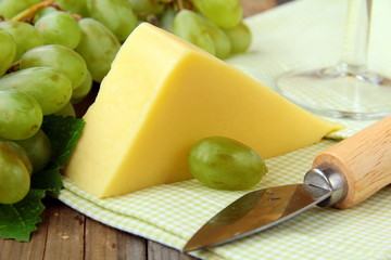 Still-life with grapes white wine  and piece of cheese