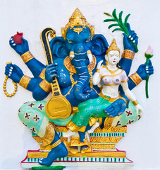 Blue ganesha with angel on white wall