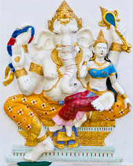 Golden dresses ganesha with angel on white wall