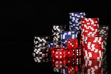 Casino chips on black background