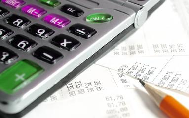 Calculator,pen and bills