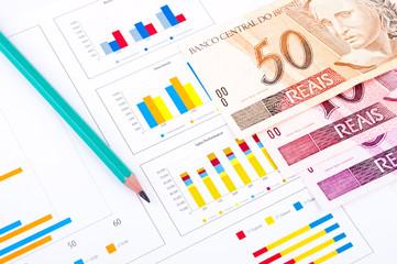 financial chart, Brazilian money and pen