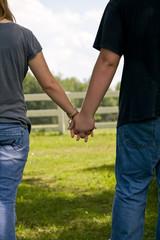 teenage couple holding hands, summer love