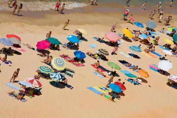 ALGARVE, PORTUGAL - JULY 28: crowded beautiful beach at Falesia,