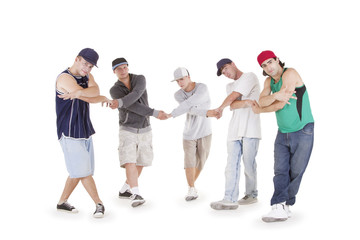 Group of young teenagers posing over white