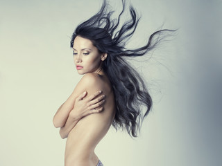 Beautiful nude woman with magnificent hair