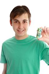 Smiling boy holding money rolled up