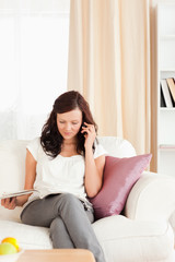 Woman on the phone reading a magazine