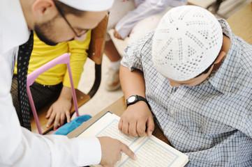 Teacher helping children in classroom