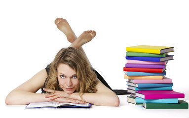 Girl lying on floor and reading, looking at camera