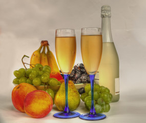 Champagne in glasses and fruits