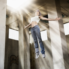 Girl floating up to bright light.