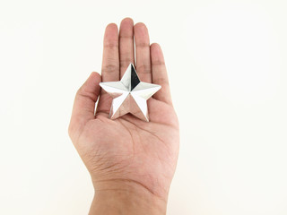 Silver star on hands