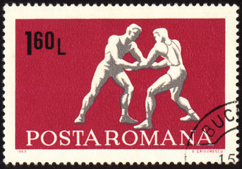 Wrestling on post stamp