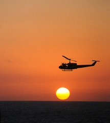 Printed roller blinds Helicopter Helicopter at sunset