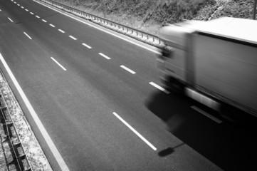 truck is going along the asphalt highway