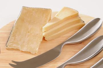 Cheese on cutting board.