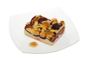 Fresh baked plum cake with pwdered sugar