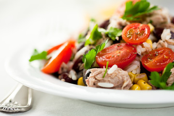 Rice salad with vegetables and tuna