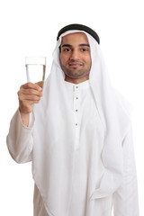 Happy arab man holding a glass of fresh drinking water