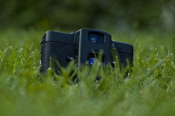 Vintage camera in grass