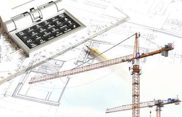 Bau - Baukran mit Bauplan und Taschenrechner