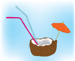 Coconut cocktail with tubules and an umbrella.