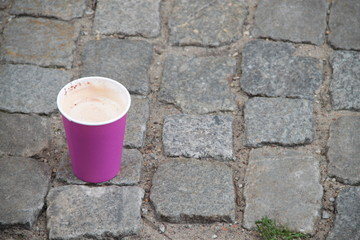 A cup of coffee on the ground