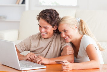Cute couple with a laptop