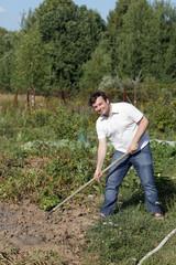 Man poses with rake